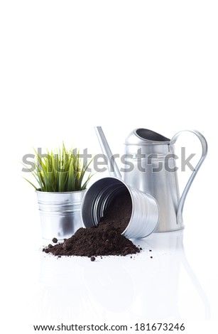 metal watering can and garden pots  - stock photo