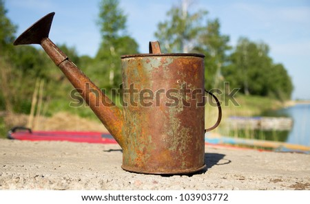 metal watering old - stock photo