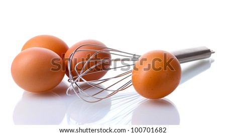Metal whisk for whipping eggs and brown eggs isolated on white - stock photo