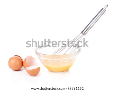 Metal whisk for whipping eggs and eggs in bowl isolated on white - stock photo