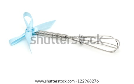 metal whisk with a blue ribbon over white - stock photo