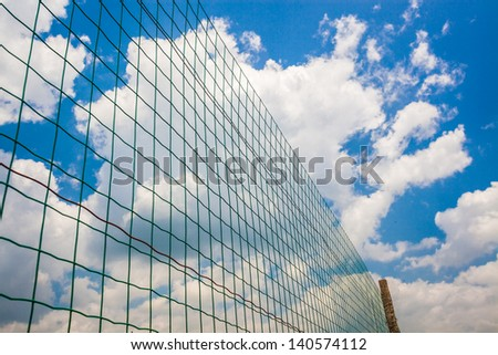 metal wire fence under blue sky