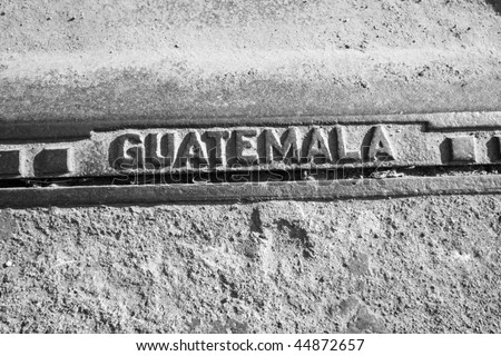 Metal with the word 'Guatemala' stamped on it on street in Antigua, Guatemala. - stock photo