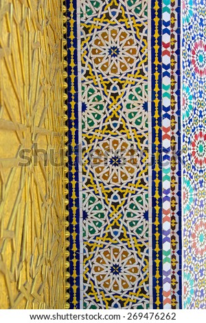 Metal work and mosaic on the gate to the palace of the king of Morocco in Fez, Morocco - stock photo