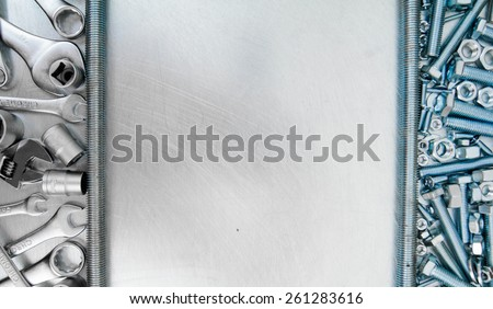 Metal working tools Metal style. Metal tools and fixing elements on the scratched metal background. - stock photo