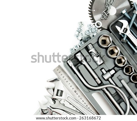 Metal working tools. Metalwork. Box, saw, spanner and others tools on white background. - stock photo