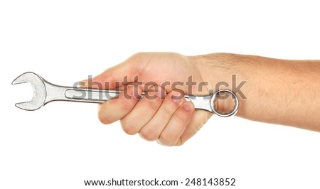 Metal wrench in male hand isolated on white - stock photo
