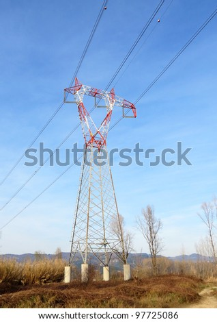 Metalic mast for high voltage electric energy transmision. - stock photo