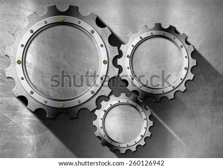 Metallic Background with Metal Gears. Stainless metal background with three empty metallic gears with copy space and shadows - stock photo