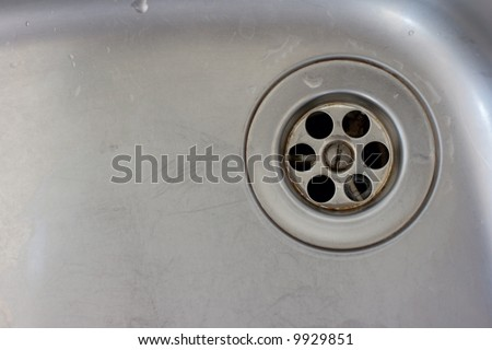 Metallic background with the drain in a wash basin - stock photo