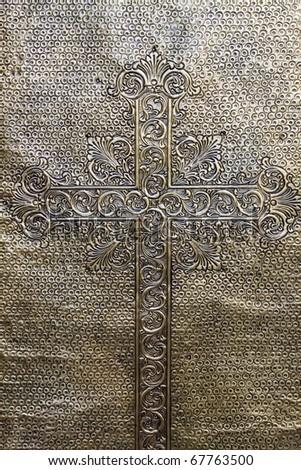 Metallic Door with Engraved Cross - stock photo