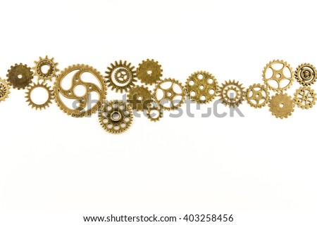 metallic gears background / Closeup of metal cog gears / close up texture pattern steampunk style and old mechanical peaces / decorative frame - stock photo