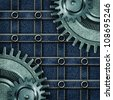 metallic gears with jeans background - stock photo