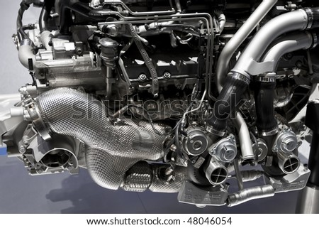 Metallic shiny new internal combustion engine showing details
