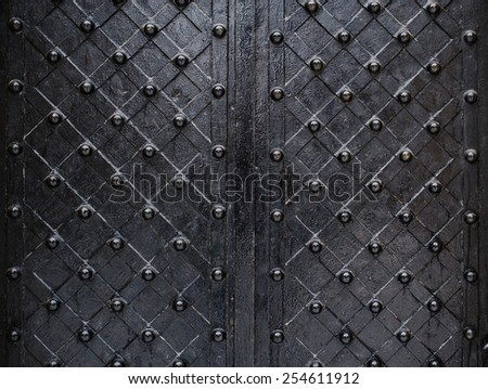 metallic texture black elements of the old door. - stock photo