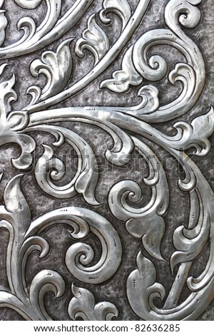 metallic texture embossed into an ancient doorway - stock photo