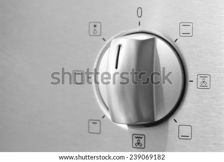 Metallic Toggle Switch of Cooker Oven. Close-up View - stock photo
