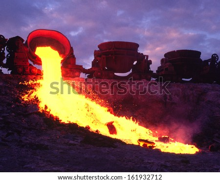 metallurgic  dumping waste into slurry pits, pollution - stock photo