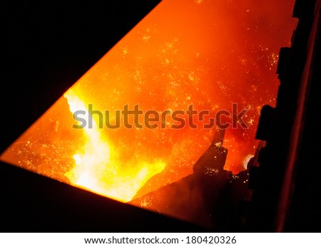 Metallurgical equipment and technology of iron production. Molten hot steel. - stock photo