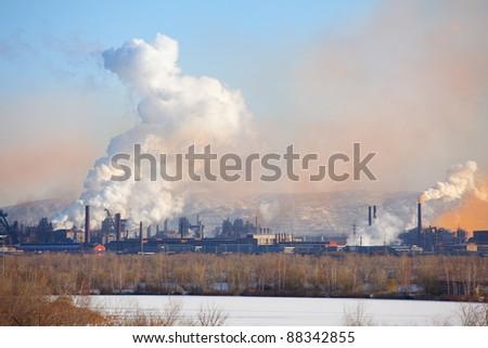 Metallurgical factory. Environmental contamination. Smoke pipe. - stock photo