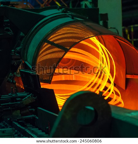 metallurgical production, manufacture of metal wire mill - stock photo