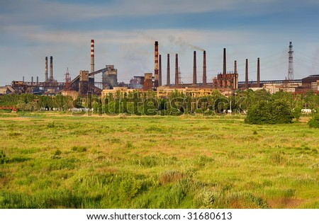 metallurgical works with brown smog - stock photo