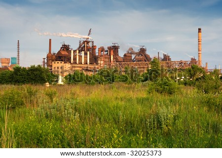 metallurgical works with smog - stock photo