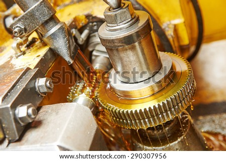 metalworking industry: tooth gear wheel machining by hob cutter mill tool - stock photo