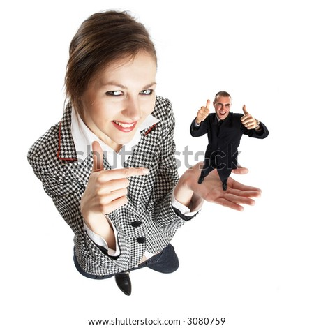 Metaphor - Young attractive businesswoman with open palm toward camera - holding happy businessman - stock photo