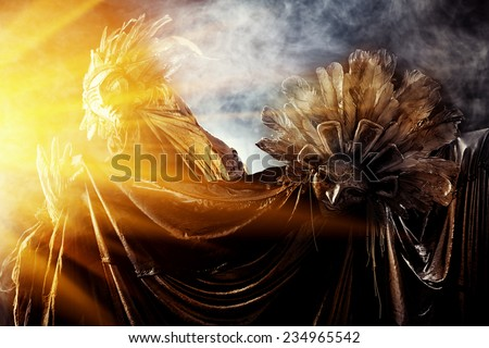 Metaphorical idea of the sun and the moon. Folklore. Paganism, worship of the sun and the moon. - stock photo