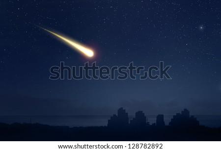 Meteor Comet over the nigt sky city landscape - stock photo