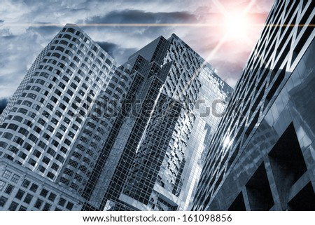 meteor in the sky over skyscrapers, apocalyptic concept - stock photo