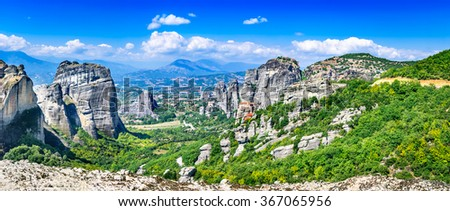 Meteora, Greece. Mountain scenery with Meteora rocks and Roussanou Monastery, landscape place of monasteries on the rock, orthodox religious greek landmark in Thessaly - stock photo