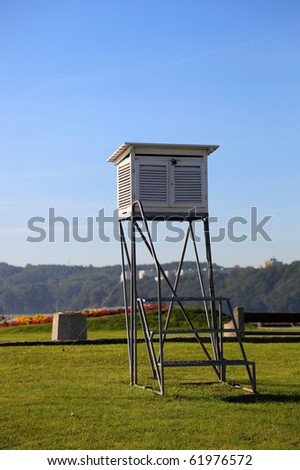 Meteorological station on the background of grass. - stock photo