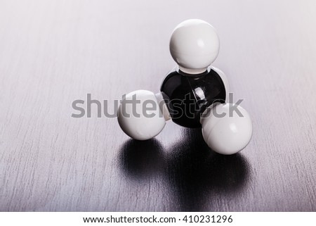 Methane chemical molecular structure model on a wooden surface - stock photo