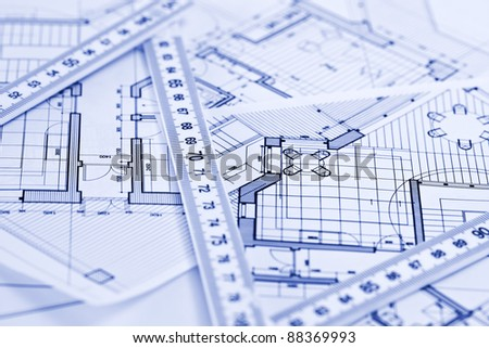 metric folding ruler and architectural drawings of the modern house - stock photo