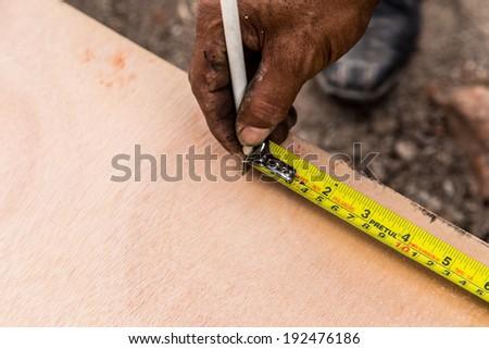 Metric tape in wood - stock photo