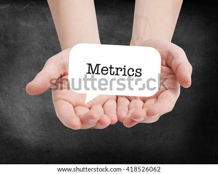Metrics written on a speechbubble - stock photo