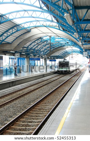 Metro arriving in Medellin train station, Colombia - stock photo