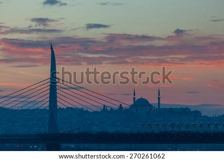 Metro bridge and Fatih Mosque Golden Horn in Istanbul, Turkey - stock photo