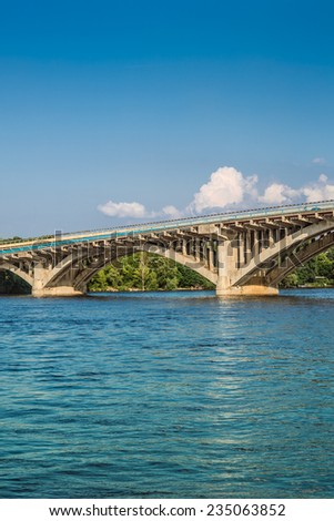 Metro Bridge is part of Brovary Parkway spanning across Dnipro River in Kyiv, capital of Ukraine. It was engineered by G. Fux and Y. Inosov and constructed in 1965 with expansion of Kyiv Metro system. - stock photo
