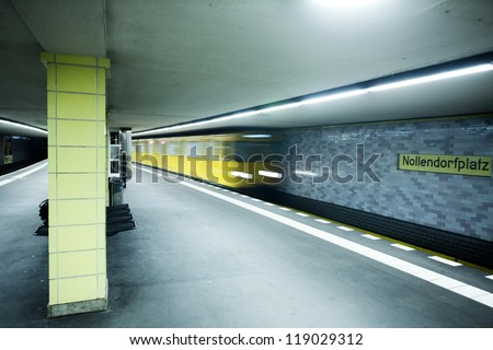 Metro coming to station, Berlin - stock photo