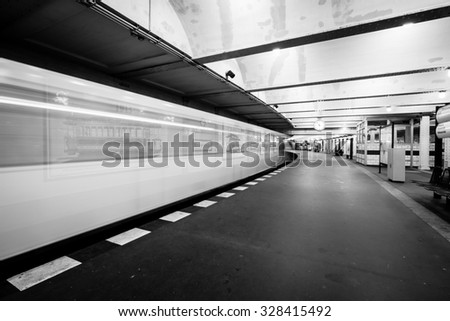 Metro station. The arrival of the train. Motion blur. Black and white.