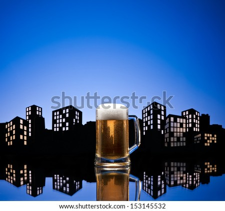 Metropolis lager beer  in color skyline setting - stock photo