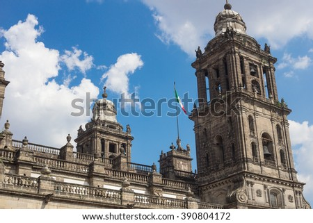 Metropolitan cathedral of Mexico city in Zocalo square and mexican flag. - stock photo