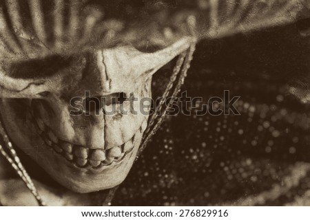 Mexican Bandit Skeleton 9. A skeleton wearing a Mexican sombrero and a poncho. Edited in a vintage film style. - stock photo