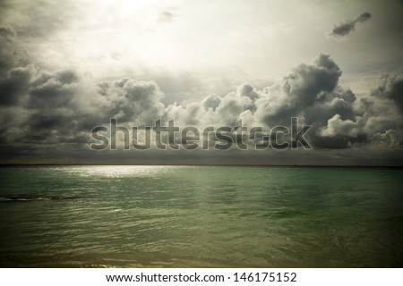Mexican beach and very dramatic and emotional sky and clouds
