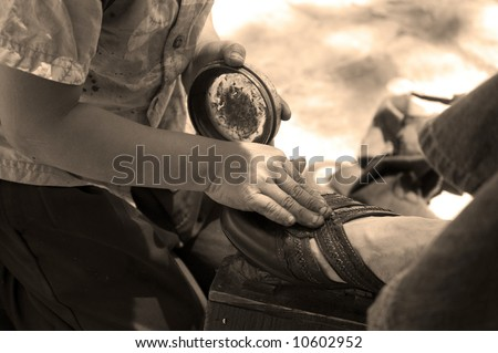 Mexican boy working hard to polish shoes in Chiapas, Mexico - stock photo