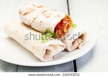 Mexican burritos on a plate - stock photo