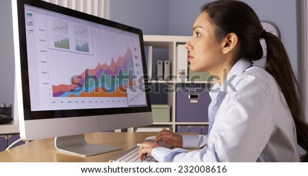 Mexican businesswoman working overtime  - stock photo